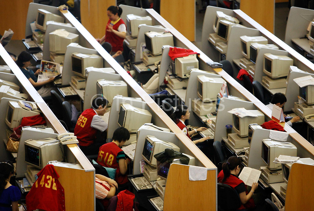 Traders work on the floor of the Shanghai Stock Exchange in Shanghai, China on 16 June 2009.  China's stock market only started in the 1990's but it is already introducing some of the world's biggest initial public offerings as large state own companies tap into the capital market.