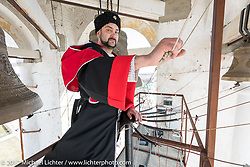 Eugene Iliinskiy-Fon-Ernen, a Cossack bell ringer in uniform ringing the bells in a bell tower as he does many times a day in Suzdal, Russia, an 11th century Golden Ring town. Tuesday April 25, 2017. Photography ©2017 Michael Lichter.