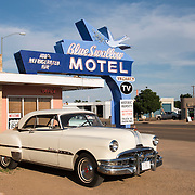 Blue Swallow Motel in Tucumcari, New Mexico with vintage Pontiac Eight car