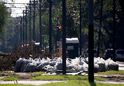 06 Oct, 2005.  New Orleans, Louisiana.  Hurricane Katrina aftermath. <br /> Garbage piles up on the Mardi Gras parade route and street car line of St Charles Ave in the Uptown neighbourhoods.<br /> Photo; ©Charlie Varley/varleypix.com