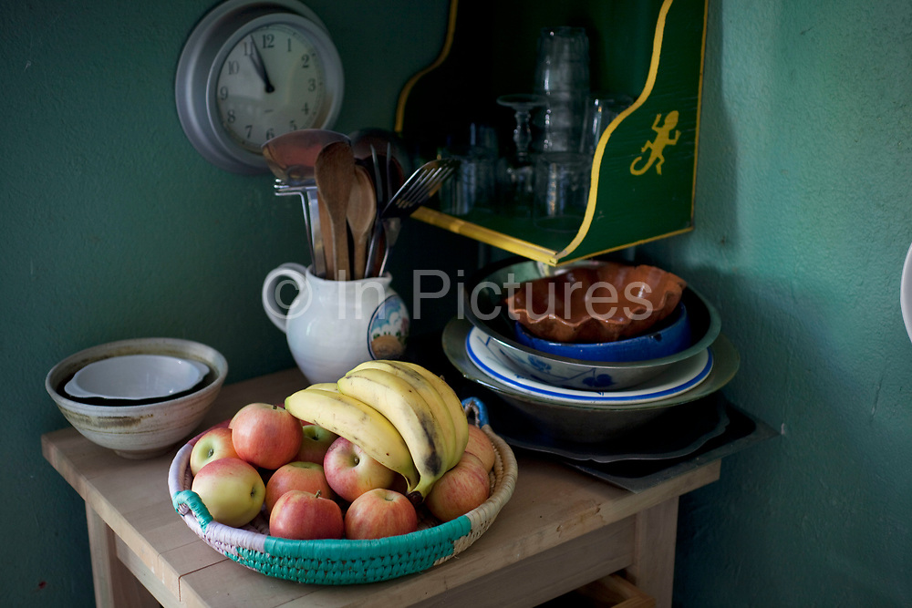 Scene inside a French country village house. This classical place with it's objects looks like a still life of French living. Fruit and cooking utensils