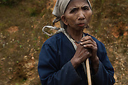 Local tribe woman holding stick, does not know her own age