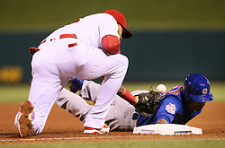 September 28, 2017 - St Louis, MO, USA - The Chicago Cubs' Leonys Martin, right, returns safely to first base as St. Louis Cardinals first baseman Jose Martinez is unable to catch the pickoff throw from pitcher Lance Lynn in the fifth inning on Thursday, Sept. 28, 2017, at Busch Stadium in St. Louis. The Cubs won, 2-1. (Credit Image: © Chris Lee/TNS via ZUMA Wire)