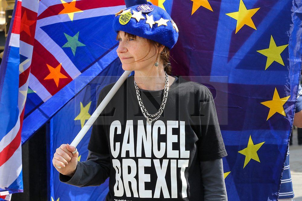"""© Licensed to London News Pictures. 30/04/2019. London, UK. An anti-Brexit demonstrator wearing an EU flag cap and a """"Cancel Brexit"""" t-shirt protesting outside the Houses of Parliament. Photo credit: Dinendra Haria/LNP"""