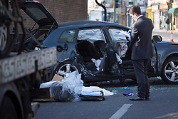 © licensed to London News Pictures. London, UK 29/03/2013. A detective investigating the scene where two men died in a collision shortly before 2am on Friday 29 March on Seven Sisters Road in north London. Two male passengers in the Audi, both believed to be aged in their late 20s or early 30s, died in the collision. Photo credit: Tolga Akmen/LNP