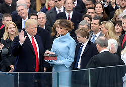 Chief Justice of the United States John G. Roberts, Jr. administers the oath of office to President Donald Trump during the 58th Presidential Inauguration on January 20, 2017 in Washington, DC..Photo by Olivier Douliery/Abaca