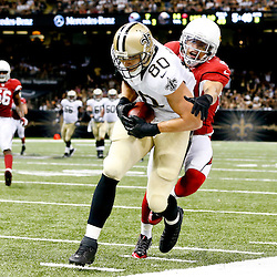 Sep 22, 2013; New Orleans, LA, USA; New Orleans Saints tight end Jimmy Graham (80) is tackled by Arizona Cardinals during a game at Mercedes-Benz Superdome. The Saints defeated the Cardinals 31-7. Mandatory Credit: Derick E. Hingle-USA TODAY Sports