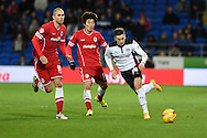 Tom Lawrence of Rotherham Utd ® breaks away from Cardiff's Matthew Connolly (l) and Kim Bo-Kyung (c). Skybet football league championship match, Cardiff city v Rotherham Utd at the Cardiff city stadium in Cardiff, South Wales on Saturday 6th December 2014<br /> pic by Andrew Orchard, Andrew Orchard sports photography.