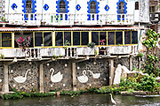 A unusual building decorated with swans along the Papaloapan River in Santiago Tuxtla, Veracruz, Mexico.