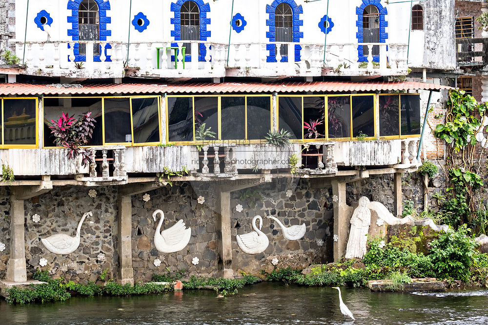 A unusual building decorated with swans along the Papaloapan River in Santiago Tuxtla, Veracruz, Mexico.