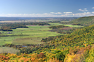 View of Quebec farmland in the early fall. The Champlain Lookout is located on the edge of the Eardley Escarpment which is the dividing line between the Canadian Shield and the St. Lawrence Lowlands. Photographed from the Champlain Lookout at Gatineau Park in Chelsea, Québec, Canada.