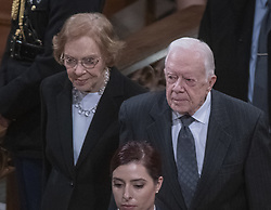 Former United States President Jimmy Carter, right, and former first lady Rosalynn Carter, left, depart following the National funeral service in honor of the late former US President George H.W. Bush at the Washington National Cathedral in Washington, DC on Wednesday, December 5, 2018.<br /> Photo by Ron Sachs / CNP/ABACAPRESS.COM