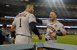 October 25, 2017 - Los Angeles, California, U.S. - Houston Astros' Jose Altuve (27) celebrates with teammate Carlos Correa (1) after hitting back to back home runs against the Los Angeles Dodgers in the tenth inning of game two of a World Series baseball game at Dodger Stadium on Wednesday, Oct. 25, 2017 in Los Angeles. Houston Astros won 7-6 in 11 innings. (Photo by Keith Birmingham, Pasadena Star-News/SCNG) (Credit Image: © San Gabriel Valley Tribune via ZUMA Wire)