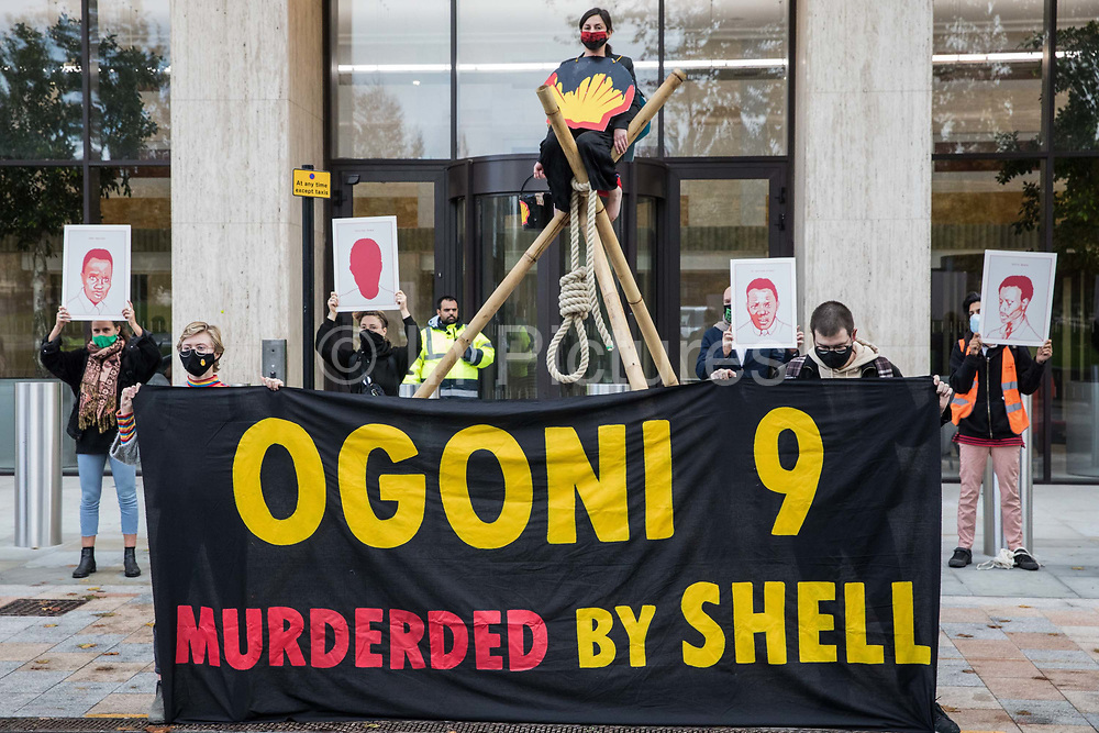 Environmental activists from Extinction Rebellion protest using a tripod and noose outside the Shell Centre on the 25th anniversary of the killings of the Ogoni Nine on 10 November 2020 in London, United Kingdom. The Ogoni Nine, leaders of the Movement for the Survival of the Ogoni People (MOSOP) including activist Ken Saro-Wiwa, were executed by the Nigerian government in 1995 after having led a series of peaceful marches involving an estimated 300,000 Ogoni people against the environmental degradation of the land and waters of Ogoniland by Shell and to demand both a share of oil revenue and greater political autonomy.