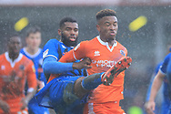 Ethan Ebanks-Landell wins a challenge during the EFL Sky Bet League 1 match between Rochdale and Shrewsbury Town at Spotland, Rochdale, England on 9 March 2019.