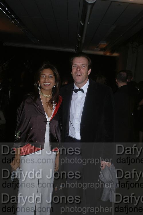 Divia Lalvani and Joel Cadbury, The Black and White Winter Ball. Old Billingsgate. London. 8 February 2006. -DO NOT ARCHIVE-© Copyright Photograph by Dafydd Jones 66 Stockwell Park Rd. London SW9 0DA Tel 020 7733 0108 www.dafjones.com