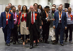 © Licensed to London News Pictures. 12/06/2015. London, UK. Labour's JOHN BIGGS (centre) with Labour party supporters at the Excel Centre in London. Lutfur Rahman was removed from office for fraud and corrupt practices by an election court earlier this year and the 2014 election was rerun as a result. Photo credit : Vickie Flores/LNP
