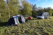 """Environmental activists camping site is seen next to HS2 construction site in Crackley Woods, Coventry, on Tuesday, April 14, 2020. (Photo/Vudi Xhymshiti)<br /> The HS2 construction works are seen to continue with """"business as usual"""" in Crackley Woods, Coventry construction site.<br /> HS2 investors are challenging Public Health England and World Health Organisation guidance which aims to curb the spread of coronavirus pandemic outbreak in Britain. Although Britain has seen over 12 thousand of its citizens dying due to Covid19 outbreak since January this year, Government has given the green light for companies to start putting spades in the ground to build a new high-speed rail line, saying work could proceed in line with coronavirus safety guidelines despite the national lockdown."""