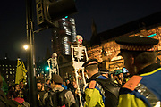 April, 18th, 2019 - London, Greater London, United Kingdom: Police and skeletons at Westminster Parliament Square during Demonstration against Climate Crisis. Extinction Rebellion is demanding the UK government takes urgent action on climate change and wildlife declines. Extinction Rebellion activists disrupt traffic around famous London Landmarks. Thousands of protesters  converging on central hubs including Oxford Circus and Parliament Square. Nigel Dickinson/Polaris