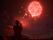 Taras Masnyk of Wheaton photographs the Wheaton Park District's 2017 4th of July fireworks display at Graf Park on July 3, 2017 with his cell phone.
