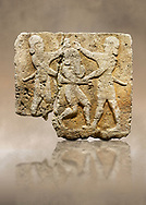 Hittite relief sculpted orthostat stone panel of Herald's Wall Limestone, Karkamıs, (Kargamıs), Carchemish (Karkemish), 900-700 B.C. Anatolian Civilisations Museum, Ankara, Turkey.<br /> <br /> This relief tells the story the killing of Humbaba, protective deity of the cedar forests, by Gilgamesh and Enkidu. The figures standing on both sides hold, with one hand, the arms of the figure in the middle transversally while they stab the dagger on the head of the figure.<br /> <br /> Against a brown art background. .<br />  <br /> If you prefer to buy from our ALAMY STOCK LIBRARY page at https://www.alamy.com/portfolio/paul-williams-funkystock/hittite-art-antiquities.html  - Type  Karkamıs in LOWER SEARCH WITHIN GALLERY box. Refine search by adding background colour, place, museum etc.<br /> <br /> Visit our HITTITE PHOTO COLLECTIONS for more photos to download or buy as wall art prints https://funkystock.photoshelter.com/gallery-collection/The-Hittites-Art-Artefacts-Antiquities-Historic-Sites-Pictures-Images-of/C0000NUBSMhSc3Oo