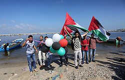 October 5, 2016 - Gaza City, Gaza Strip, Palestinian Territory - Palestinian youths hold banners during a rally to show solidarity with ship called 'ÄúZaytouna'Äù set to arrive in Gaza, at the Seaport of Gaza City October 5, 2016  (Credit Image: © Mohammed Asad/APA Images via ZUMA Wire)