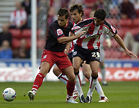 Photo: Jonathan Butler.<br />Southampton v Stoke City. Coca Cola Championship. 21/10/2006.<br />Lee Hendrie of Stoke tackles Andrew Surman of Southampton.