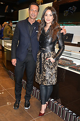 ROBERT TATEOSSIAN and ROXIE NAFOUSI at a party in celebration of LCM 2015 and the launch of the Tateossian's first ever men's-only boutique at 55 Sloane Square, London on 10th January 2015.