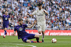 March 16, 2019 - Madrid, Madrid, Spain - Real Madrid's Marco Asensio and Real Club Celta de Vigo's Wesley Hoedt seen in action during La Liga match between Real Madrid and Real Club Celta de Vigo at Santiago Bernabeu Stadium in Madrid, Spain. (Credit Image: © Legan P. Mace/SOPA Images via ZUMA Wire)