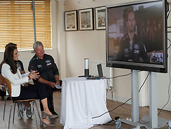 The Duchess of Cambridge speaks to sailor Sir Ben Ainslie on a video screen at the 1851 Trust charity's final Land Rover BAR Roadshow at Docklands Sailing and Watersports Centre in London.