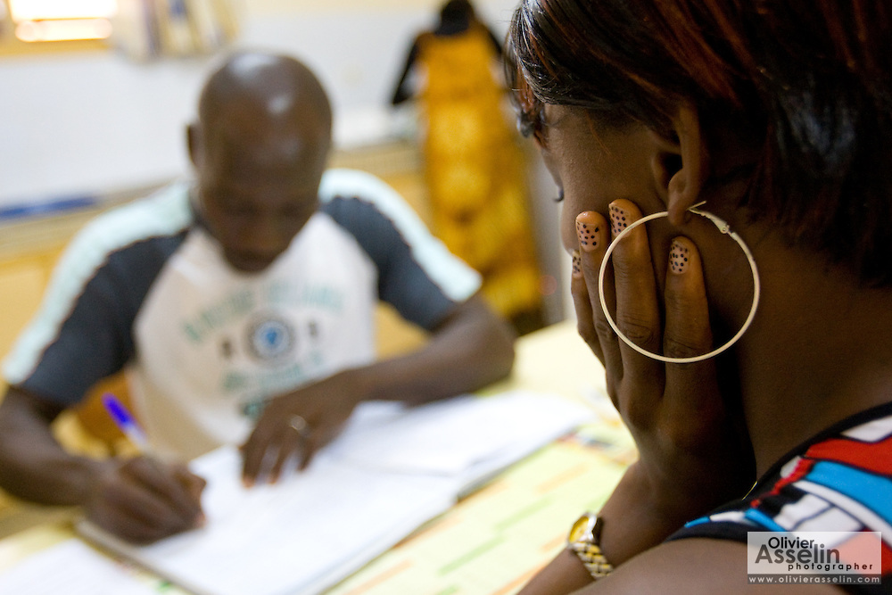 Kevin Kouassi Gallet meets with Aya Solange Siallo, 24, who came to get tested for HIV/AIDS at the NDA health center in Dimbokro, Cote d'Ivoire on Friday June 19, 2009. Siallo, who is currently pregnant of her second child, tested positive for HIV.