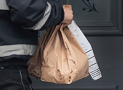 © Licensed to London News Pictures. 13/02/2020. London, UK. A delivery of take-away food from Five Guys arrives at the Fulham home of former chancellor Sajid Javid.  Sajid Javid has resigned as chancellor during the cabinet reshuffle. Photo credit: Peter Macdiarmid/LNP
