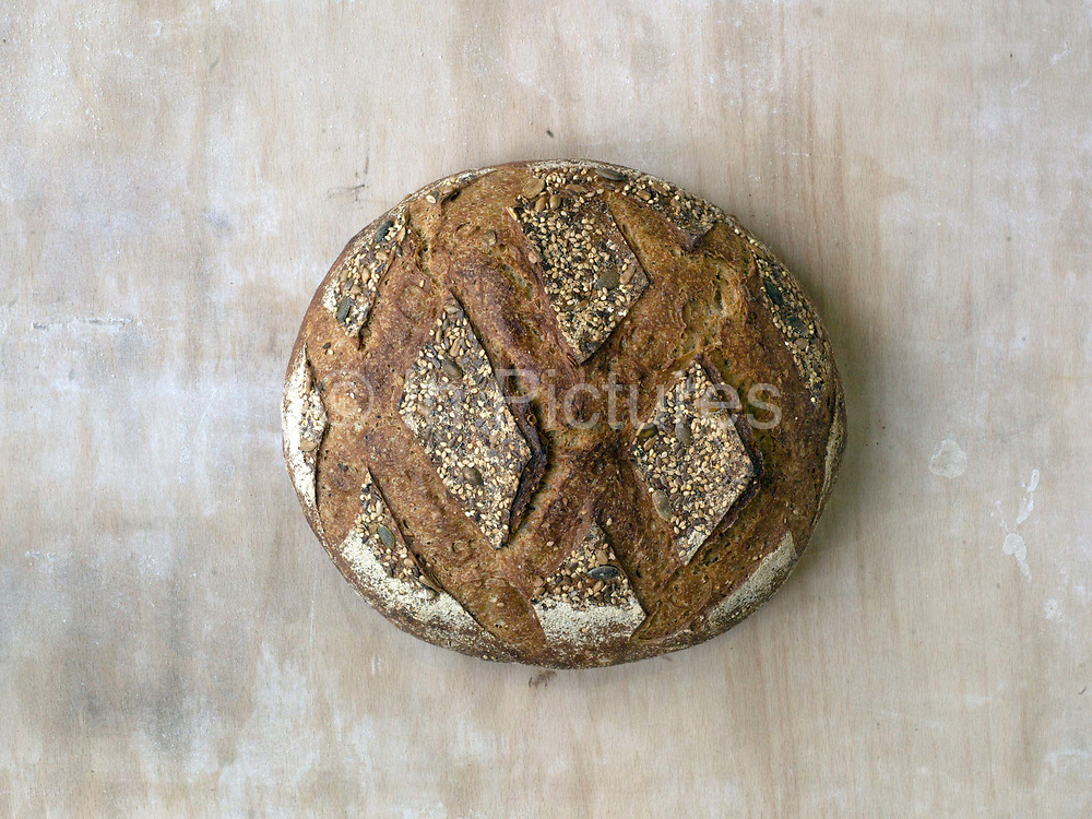Freshly baked Heritage sourdough loaf at the Haxby Bakehouse, Yorks artisan bakery in Haxby, North Yorkshire, United Kingdom on 10th February 2017. Haxby Bakehouse make bread using traditional methods of slow fermentation. They use low yeasted overnight sponges, natural sourdoughlevain or a combination of the two. This means the bread they produce is full of flavour without the use of any artificial flour improvers, preservatives or emulsifiers.