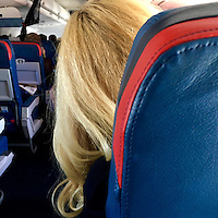 A woman leans towards the aisle in her seat on a flight from Nashville, TN to Atlanta, GA September 24, 2016.