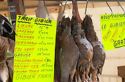 On a street market. Partridge perdreaux. And sign with other spieces. On Les Quais. Bordeaux city, Aquitaine, Gironde, France