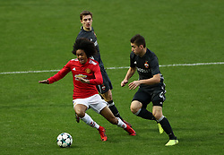 Manchester United's Tahith Chong (left) and CSKA Moscow's Ruslan Fischenko battle for the ball