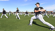 GLENDALE, AZ - FEBRUARY 24:  The Chicago White Sox stretch during spring training workouts on February 24, 2015 at The Ballpark at Camelback Ranch in Glendale, Arizona. (Photo by Ron Vesely)