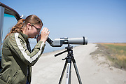 Milpitas Post reporter Shannon Barry experiences the Drawbridge Ghost Town on Station Island, near Alviso, Calif., through a telescope while on a Don Edwards National Wildlife Refuge Environmental Education Center tour.  Photo by Stan Olszewski/SOSKIphoto.