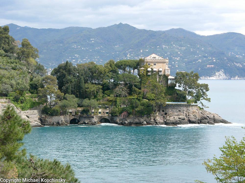 Villa, rocky coast, mountain background, sea