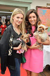 Left to right, JULIETTE LOUGHRAN with her dog Juicy and FABIANA ECCLESTONE and her dog Oscar at a party hosted by Lulu Guinness and Daphne's to launch Lulu's Designer Dog Bowl and to mark Daphne's allowing dogs through it's doors, held at Daphne's, Draycott Avenue, London on 28th June 2016.