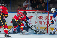 PENTICTON, CANADA - SEPTEMBER 8: Matthew Phillips #47 of Calgary Flames tries to put the puck in the net of Dylan Wells #30 of Edmonton Oilers on September 8, 2017 at the South Okanagan Event Centre in Penticton, British Columbia, Canada.  (Photo by Marissa Baecker/Shoot the Breeze)  *** Local Caption ***