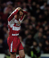 Photo: Jed Wee.<br /> Doncaster Rovers v Arsenal. Carling Cup. 21/12/2005.<br /> <br /> Doncaster Neil Roberts has his head in his hands as his penalty comes back off the post.