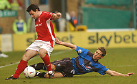 GILLINGHAM VS NOTTINGHAM FOREST<br />6TH MARCH 2004<br />GILLINGHAM'S NICKY SOUTHALL CHALLENGES ANDY REID<br /><br />Picture Ady Kerry