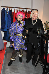 Left to right, ZANDRA RHODES and LADY COBURN at a dinner hosted by Carmen Haid at Atelier Mayer, 47 Kendal Street, London W2 on 21st February 2012.