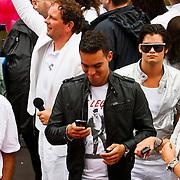 NLD/Amsterdam/20100807 - Boten tijdens de Canal Parade 2010 door de Amsterdamse grachten. De jaarlijkse boottocht sluit traditiegetrouw de Gay Pride af. Thema van de botenparade was dit jaar Celebrate, Deon