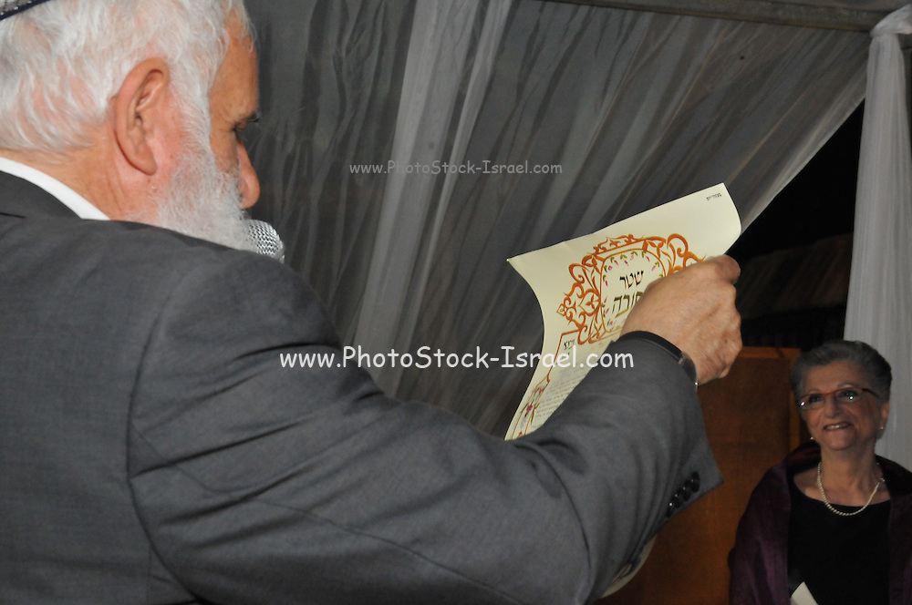 Jewish Wedding The Rabbi holds the ketubah