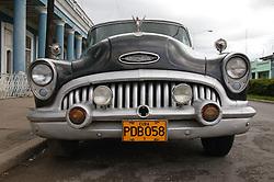 Old American car in Cuban street,