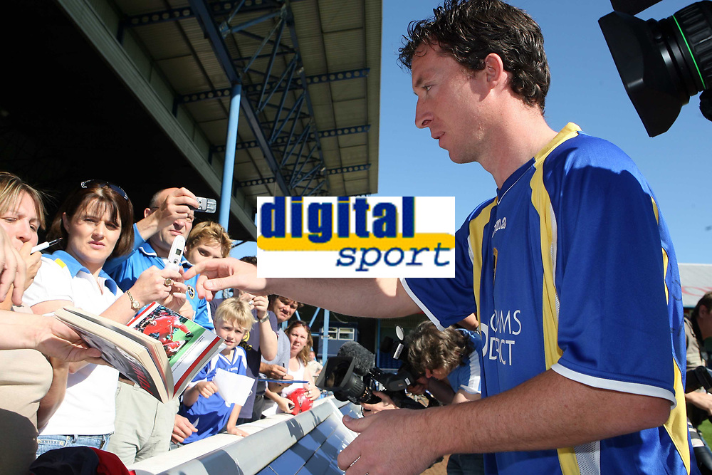 Photo: Rich Eaton.<br /> <br /> Cardiff City Press Conference. Coca Cola Championship. 24/07/2007. Robbie Fowler pictured signing shirts for fans at Ninian Park, where he was announed as a new signing by Cardiff City.