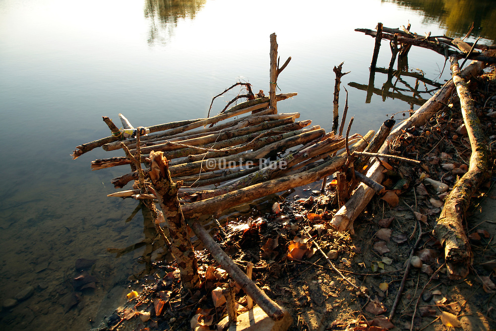 small primitive landing stage in lake