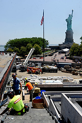 Men wearing hard hats work around the construction site when The Statue of Liberty-Ellis Island Foundation hosts a press preview of the new Statue of Liberty Museum to tie-in to the Fourth of July holiday in New York City, NY, USA on July 2, 2018. Photo by Dennis Van Tine/ABACAPRESS.COM